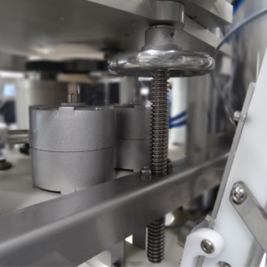 Seamer-lid dropper adjustment crank on QuickChange Gosling Canning System to accommodate multiple can sizes_Wild Goose Filling