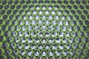 Pallet of beer cans ready for can rinsing